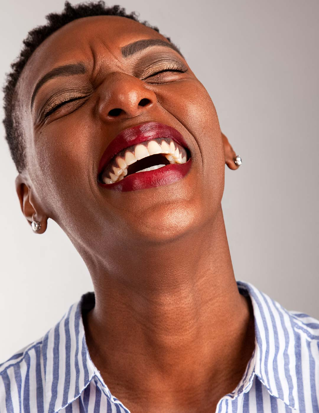 Photograph of Bettye @mybaldisbetter laughing and smiling during test shoot